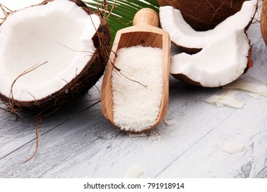 Heap of Grated Coconut on wooden background. coconut flakes concept