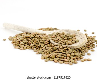 Heap of green lentil with wooden spoon isolated on white background with wooden spoon. Shallow DOF.