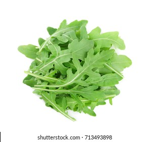 Heap of green rucola, rocket salad or arugula isolated on white background. Top view
