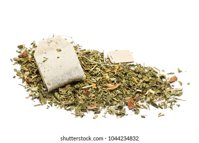heap of green tea mixture with tea bag on white background