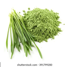heap of green wheat powder isolated on white background, selective focus