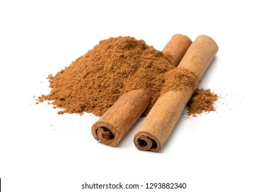 Heap of ground cinnamon and cassia cinnamon sticks isolated on white background