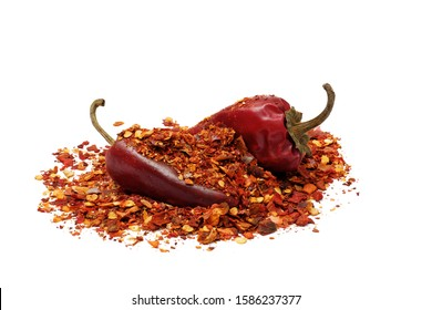 heap of ground dried chili pepper flakes and pods isolated on white background, full depth of field