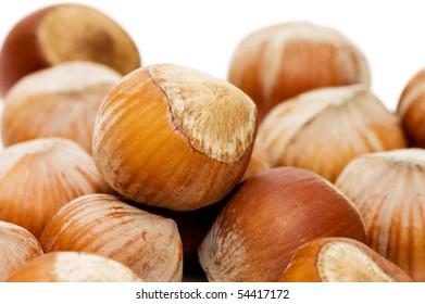 Heap of hazelnuts on white background
