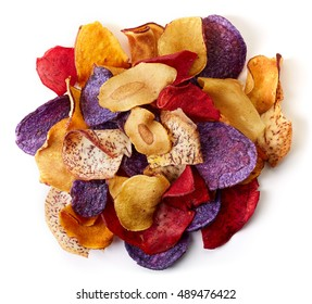 Heap of healthy colorful vegetable chips isolated on white background from top view