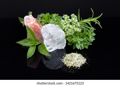 A heap of herbal salt with various herbs and salt crystals