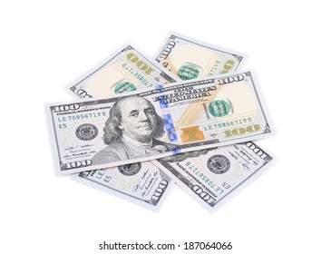 Heap of hundred dollar banknotes. Isolated on a white background.