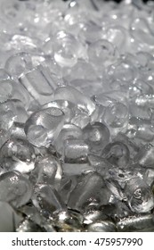 Heap of ice cubes for drinks. Frozen water background.