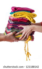 Heap of ironed washed clothes giving from hand to hand