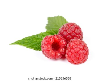 Heap of Juicy Red Ripe Raspberry with Green Leaves, Isolated on White Background