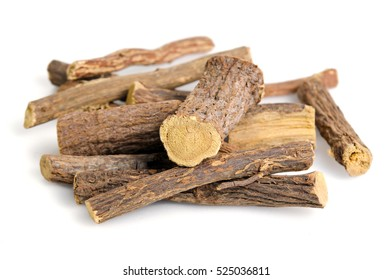 Heap of liquorice sticks isolated on white (Also called as Glycyrrhiza acanthocarpa, or glabra liquorice)