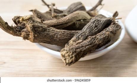 Heap of liquorice sticks isolated on white (Also called as Glycyrrhiza  acanthocarpa, or glabra liquorice)/Welmee Ayurvedic Medicine/Atimaturam/nadyapaan