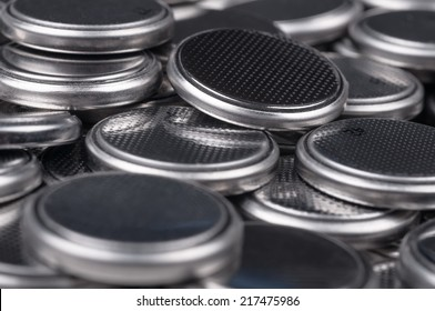 Heap of lithium button cell batteries. Closeup with shallow DOF.