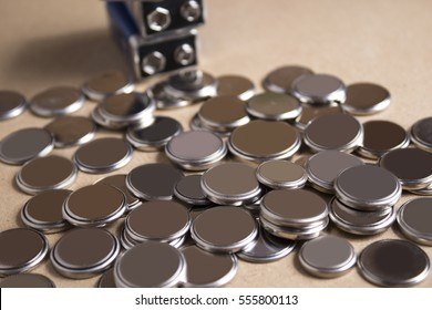 Heap of lithium button cell batteries, close up photo