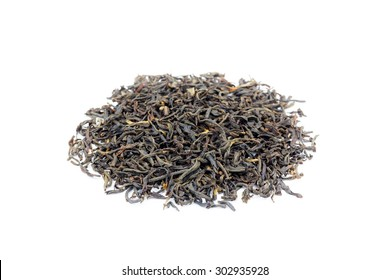 Heap of loose black tea Assam isolated on white background