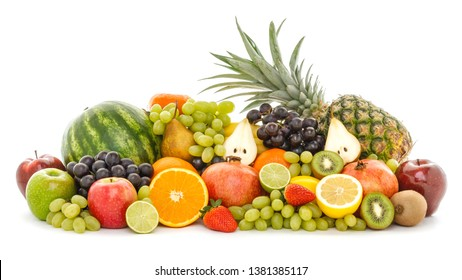 A heap of many different tropical fruits isolated on white background. Healthy food and nutrition, vegan lifestyle and organic fair trade concept.