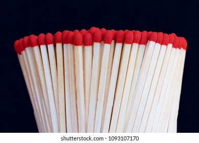 Heap of matches on a black background.