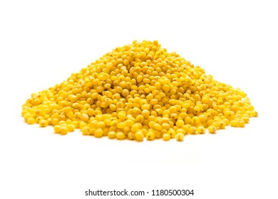 Heap of millet grains isolated on white background