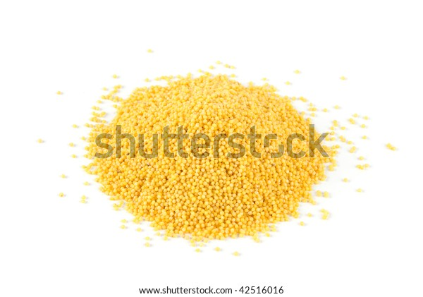Heap of millet isolated on white