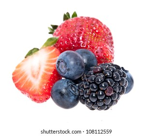 Heap of mixed berries isolated on white background