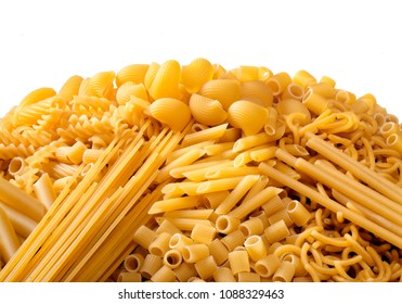 heap of mixed shapes raw pasta, food background