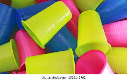 heap of multi colored plastic cups, full frame