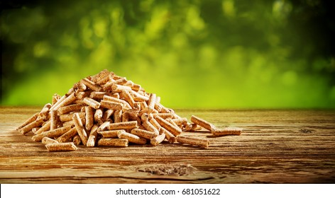 Heap of natural wood chips on a rustic table outdoors in nature in a concept of natural resources and renewable energy with copy space