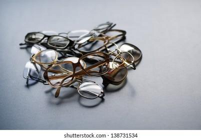 Heap of old eyeglasses