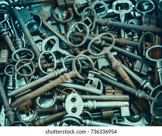 Heap of old, rusty lock key, top view