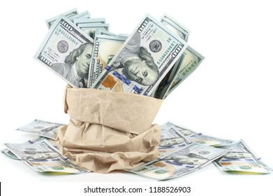 Heap of one hundred dollars in paper bag isolated on white background.