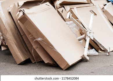 Heap of packings from paper. The scattered cardboard packings. A lot of garbage from paper. The used boxes from a cardboard