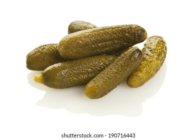 Heap of pickled cucumbers isolated on white background