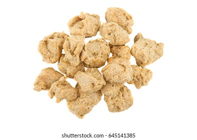 Heap of pieces dry soy meat isolated on white background. Top view
