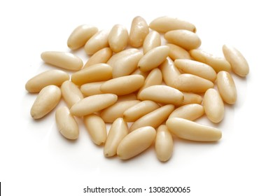Heap of pine nuts isolated on white background