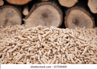 Heap of pine pellets- selective focus on the heap- stock photo