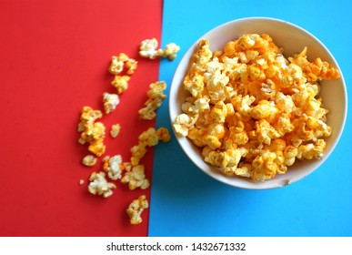 Heap popcorn caramel popcorn on red and blue background