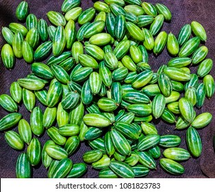 heap of potol parwal pointed gourd in vegetable market for sale