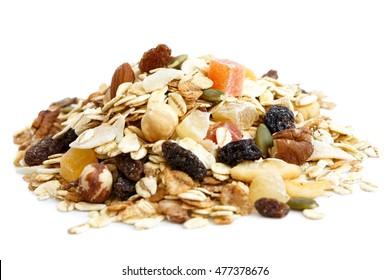 Heap of premium fruit and nut muesli isolated on white.
