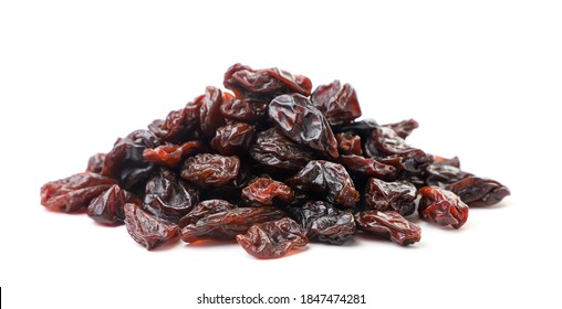 Heap of raisins on a white background. Isolated