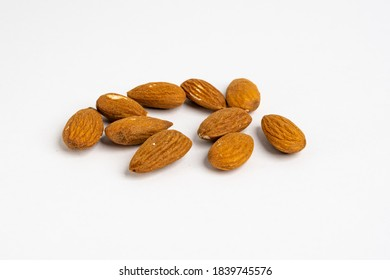 Heap of raw organic Californian almond nuts unshelled and without salt on a neutral background