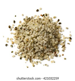 Heap of raw peeled hemp seeds on white background
