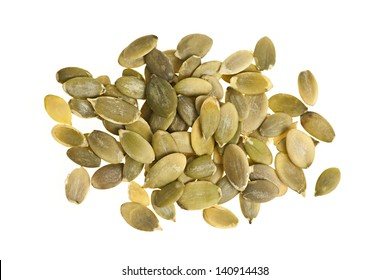 Heap of raw pumpkin seeds isolated on white background