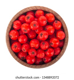 heap of red ashberries in wooden cup isolated. top view