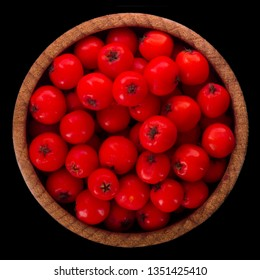 heap of red ashberry in wooden cup isolated on black background. top view