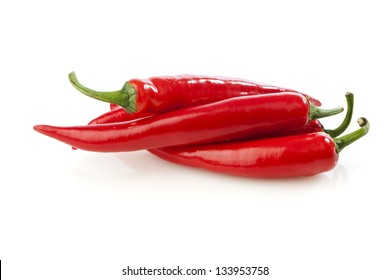 Heap of red chili peppers isolated on white background