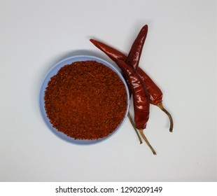 Heap of Red Chilli Pepper Powder Also Know as Mirchi, Mirchi Powder, Lal Mirchi, Mirch or Laal Mirchi isolated on White Background