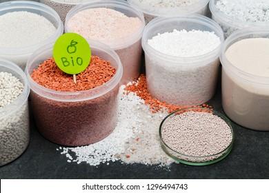 heap of red fertilizer in jar. Nitrogen (N): leaf growth,Phosphorus (P): Development of roots,Potassium (K): Strong stem growth