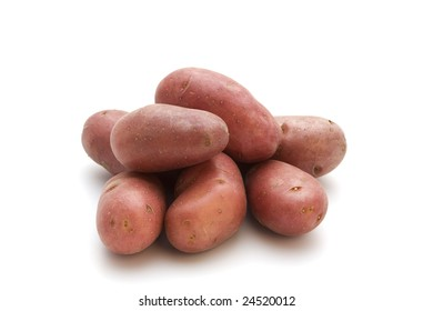 heap of red french miniature potatoes isolated on white