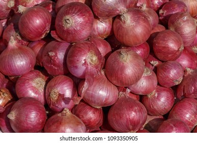 heap of red onion on market