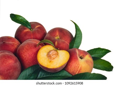 heap of red peaches with some leaves, on white background